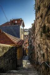 Narrow stone staircase down between ancient houses in the center of Porto, Portugal