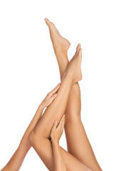 Female legs on white background