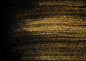 Gold explosion glitter texture isolated on black background.