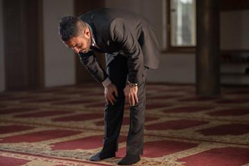 Muslim bowing in prayer