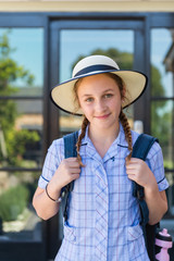 high school student with hat and backpack