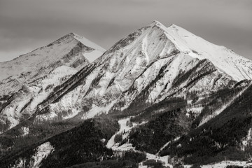 The mountain peaks of La Grande and Petite Autane covered in snow in winter. Black & White. Ecrins...
