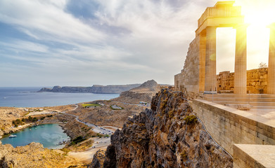 Papiers peints Athenes Greece. Rhodes. Acropolis of Lindos. Doric columns of the ancient Temple of Athena Lindia setting sun above the columns