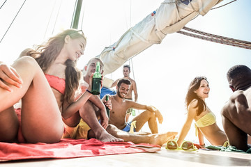 Happy rich friends having boat party in caribbean sea