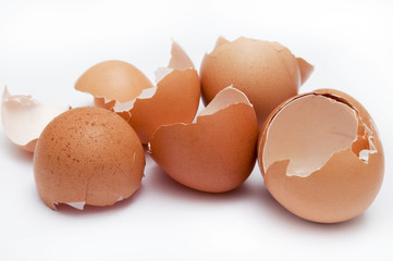 broken many empty eggshells over white background
