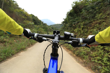 cyclist use smartphone for navigator when riding mountain bike on forest trail