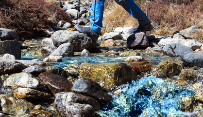 Small Mountain Creek and Hiker crossing it