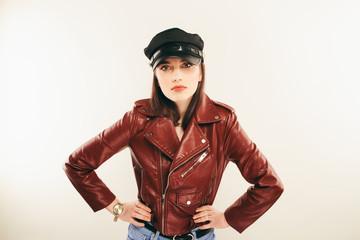 Rock chick in leather jacket, full length. Fashion portrait of elegant woman, studio shot
