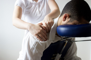 business man receiving shiatsu on massage chair