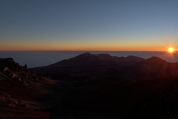 Sunrise breaks at Mount Haleakala, Maui