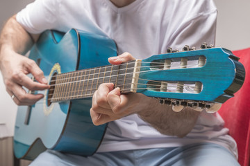 Classical musicians playing guitars
