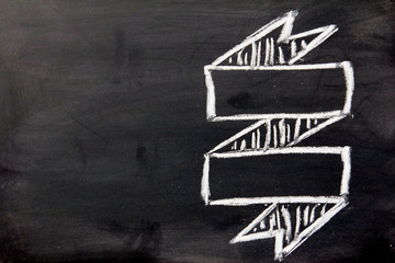 Blank ribbon draw by white chalk on black board background