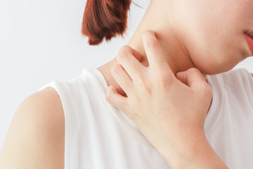 Women scratch the itch with hand /neck itching/ Concept with Healthcare And Medicine.