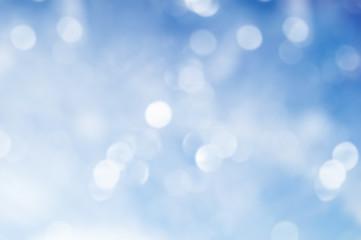A blue blurred bokeh background