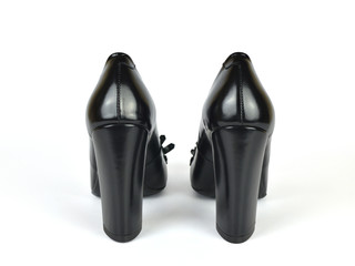 Black elegant leather high heel loafer shoes on white