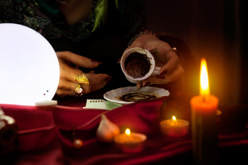 Fortune teller holds an empty coffee mug