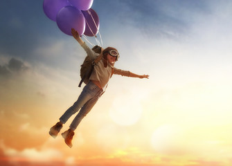 Child flying on balloons Wall mural