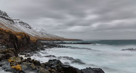 Waves hitting rocks - long exposure - breathtaking Iceland in winter - amazing landscapes, storms and blizzards - photographers paradise