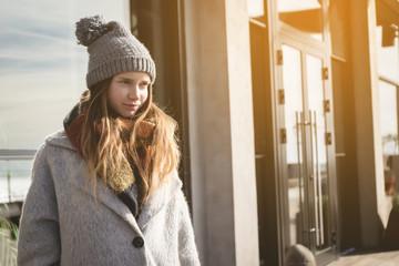 Thinking teenager outdoor,shining sunny day,coat