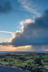 Storm cloud hanging over the ocean off the coast of Hellnar - breathtaking Iceland in winter - amazing landscapes, storms and blizzards - photographers paradise
