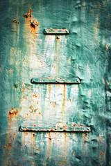 Detail of an old green metal sheet