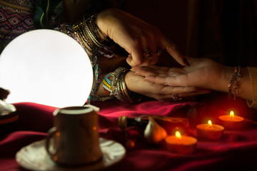 Gypsy woman read future from palm to a customer
