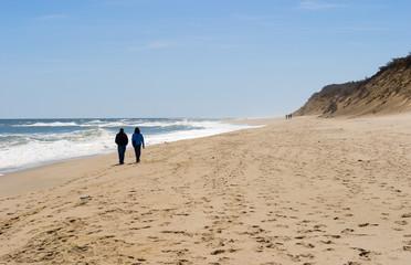 couple walking along seashore at Cape Cod