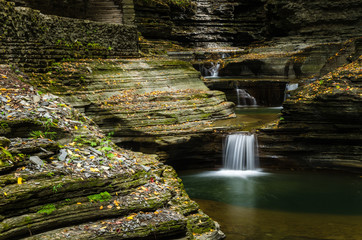 Beautiful Waterfall at he Bottom of a Gorge in Watkins Glen State Park, Upstate New York