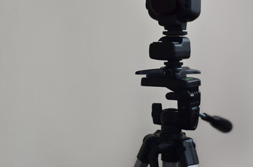 External photographic speedlight gun is mounted on the multichannel sync trigger set, which stands on a tripod. lighting equipment for studio photography. Set of professional photographer