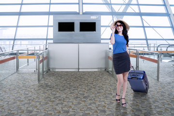 Attractive woman standing in airport