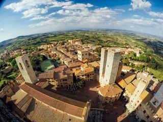 Panoramic view of sunny San Gimignano countryside, Tuscany, Italy