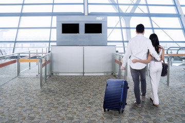 Couple with luggage in airport