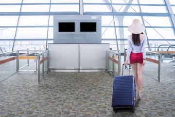 Female traveler walks in airport