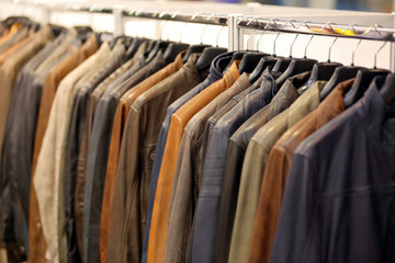 Row of men's jackets hanging on hanger