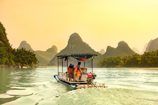Tourists cruising Li River in Yangshuo, China