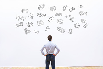 social media or network concept background, man looking at the icons of tweet, share, like and blog
