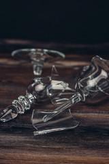 broken glassware, glass, glass on a wooden background