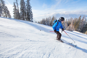 downhill skiing, skier going fast down the mountain, winter sport background