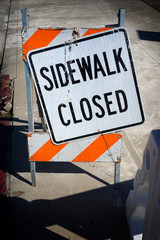 sidewalk closed sign at construction site