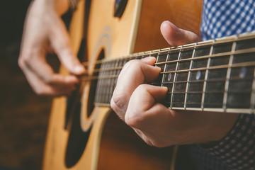 Close up of guitarist hand playing guitar