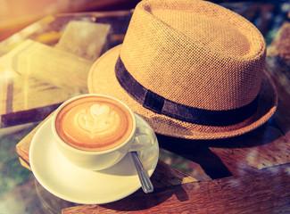 coffee latte art with Trendy stylish men hat