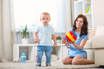 Mother with child playing in the home