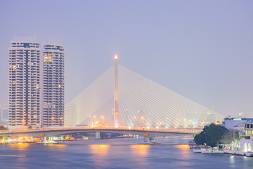 Twilight of Rama 8 bridge Chao Phraya river, the famous landmark in Bangkok, Thailand