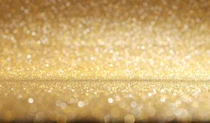 Shiny golden glitter texture background.