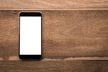 Smartphone with white screen On Wooden Table With Copyspace