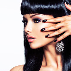 Beautiful woman with black nails and fashion makeup of eyes.