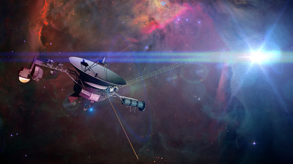 Voyager spacecraft in front of a nebula in deep space