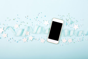 Smartphone mock up with cute decoration: heart, lace ribbon, stars and sequins  on blue background