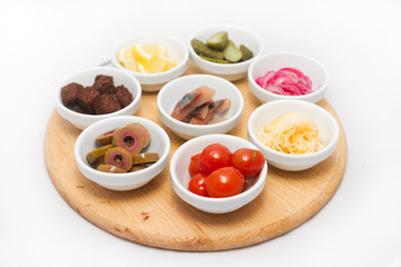 Appetizers in small plates on white background
