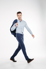 Vertical image of Smiling man in business clothes walking